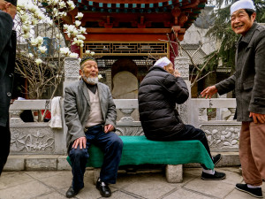Old Hui Muslim men at a Mosque in Xian. The gentleman turning his back was embarrassed about his bad teeth.